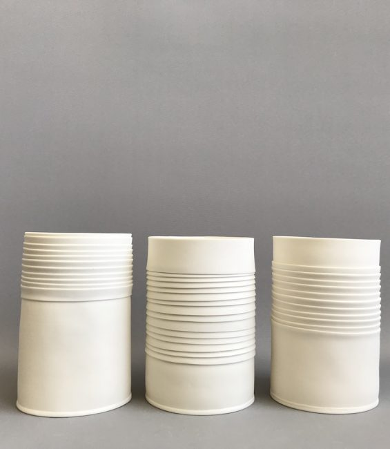 small white pleated vessels