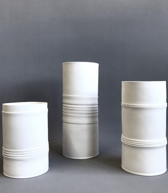 white pleated cylinders