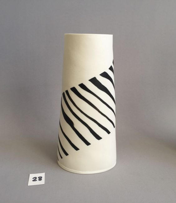 #28 stripey-patchy black and white taper