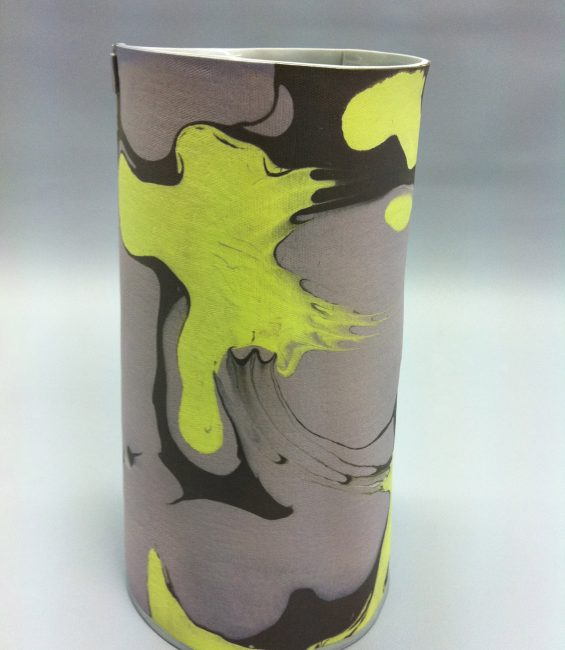 grey yellow marble cylinder