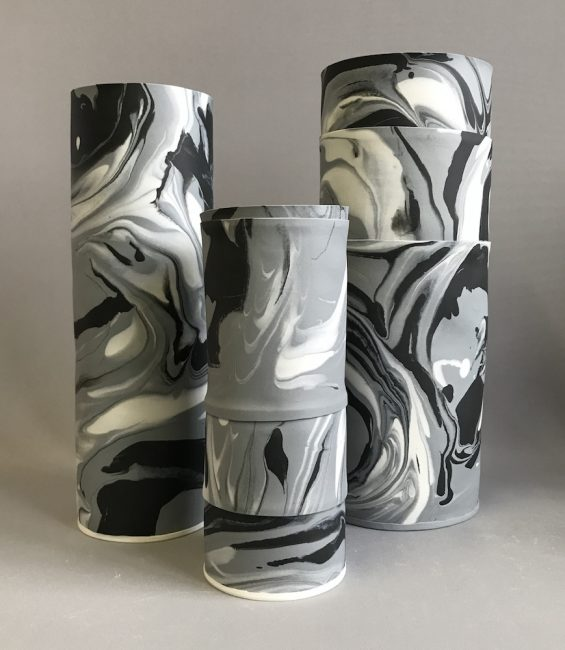 grey black white marble cylinders